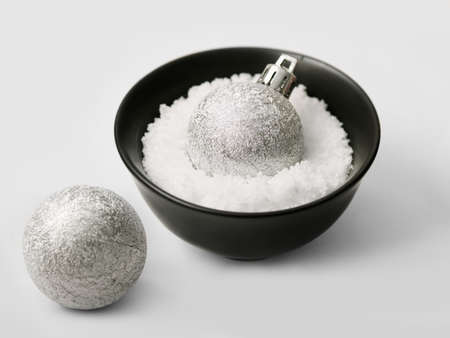 Silver balls for the Christmas tree in a bowl full of false snow Stock Photo - 15987560