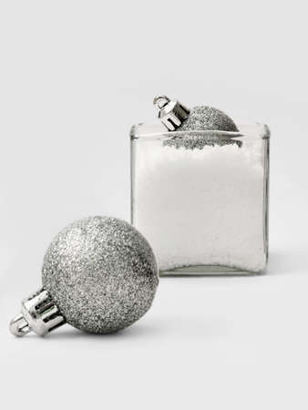 Silver balls for the Christmas tree in a vase full of false snow Stock Photo - 15987561