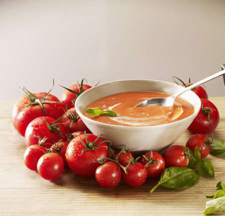 Tomato soup with cream and basil Stock Photo - 15987701