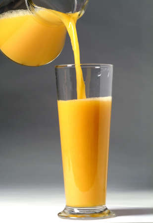 Pouring a glass of orange juice Stock Photo - 17003941