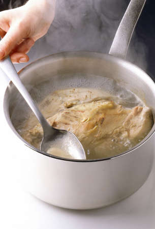 Cooking the chicken LANG_EVOIMAGES