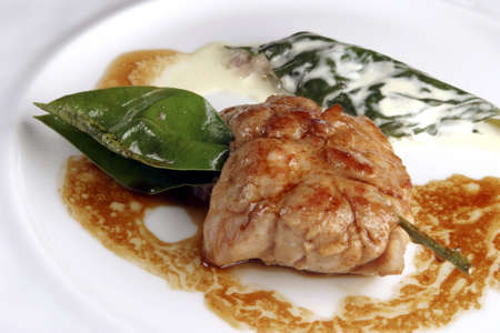 Sweetbreads pricked with bay leaves, stuffed cos leaves