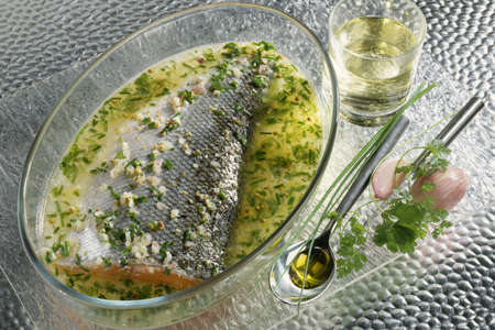 Salmon marinated with white wine and herbs