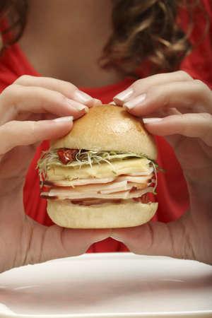 Woman eating a burger Stock Photo - 17027135