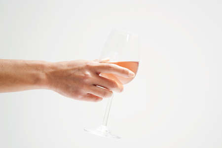 Person holding a glass of rosé wine Stock Photo - 17027168