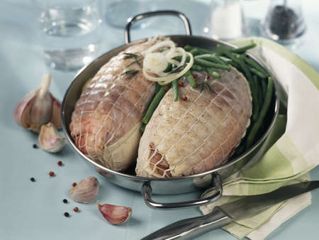 convivial: Lamb roasts with green beans before cooking
