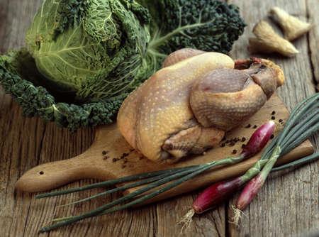 convivial: Whole raw guinea-fowl
