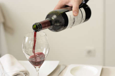 Serving a glass of red wine