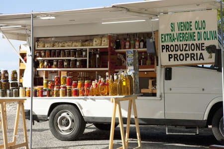 itinerant: Itinerant van selling olive oil and preserved food
