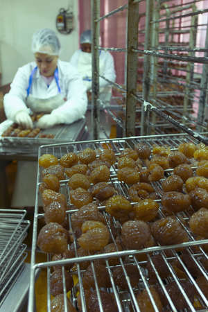 crystallized: Woman working in a candied chestnut factory LANG_EVOIMAGES