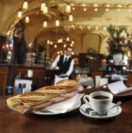 Ham sandwich and a cup of coffee on the bar in a Brasserie Stock Photo - 17028641