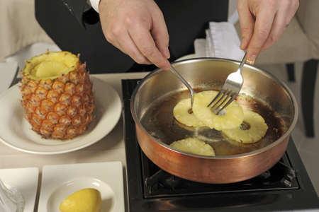 Preparing a pineapple flamb� Stock Photo - 17028782
