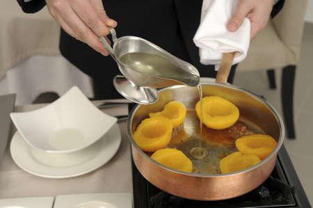 Preparing peaches flamb� Stock Photo - 17028809