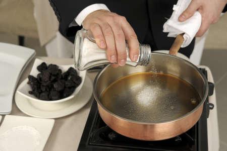 Preparing prunes flambé Stock Photo - 17028813