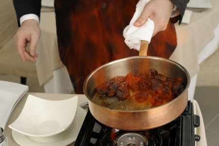 Preparing prunes flamb� Stock Photo - 17028814