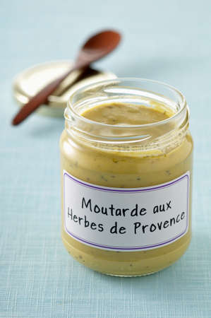 Jar of mustard with Proven�al herbs Stock Photo - 17028985