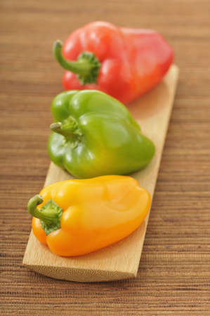 alignement: Three different colored bell peppers