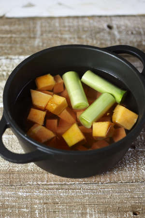 convivial: Cooking the diced pumpkin and leeks in boiling water