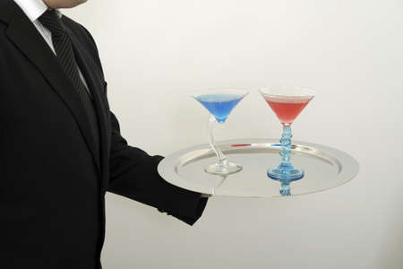Waiter serving cocktails on a tray Stock Photo - 17029127