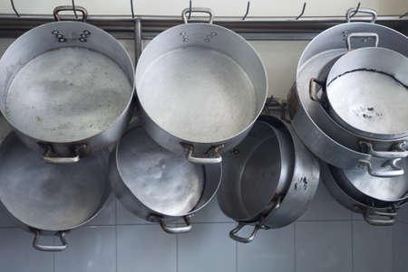 Cooking pots hanginig in a restaurants kitchen