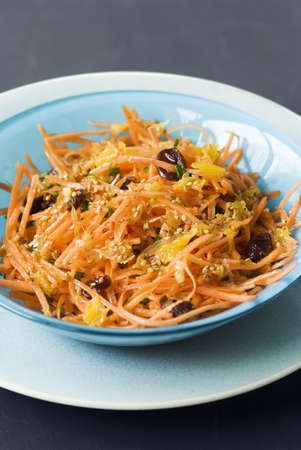 Grated carrot salad with raisins and sesame seeds Stock Photo - 17029188