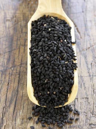 nigella seeds: Scoopful of Nigella seeds LANG_EVOIMAGES