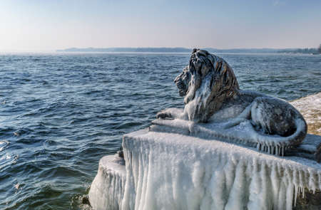 Ice-covered Bavarian Lion on a frosty winter day in Tutzing on Lake Starnberg, Upper Bavaria, Bavaria, Germany