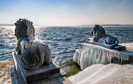 Ice-covered Bavarian Lions on a frosty winter day in Tutzing on Lake Starnberg, Upper Bavaria, Bavaria, Germany