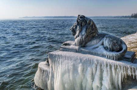 Ice-covered Bavarian Lion on a frosty winter day at Tutzing on Lake Starnberg, Upper Bavaria, Bavaria, Germany
