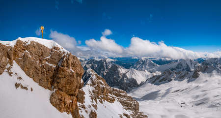 Summit cross on the Zugspitze (2962m), Germanys highest mountain, Bavaria, Germany, Europe Stock Photo