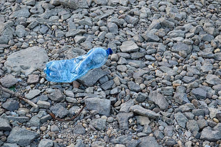 unhygienic: Plastic bottle on the shore plastic trash ocean beach sea shore polluted environmental dirt dirty river water bottle recycling polluted pollution unhygienic danger ecology Stock Photo