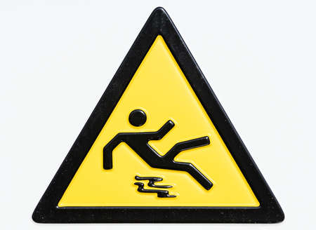 tripping: caution wet floor sign - warning sign at an entrance of a university in rome -