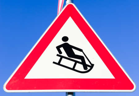 luge: luge warning sign in germany - in front of blue sky