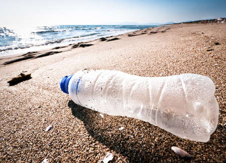 empty bottle: empty bottle at a beach in italy - grado Stock Photo