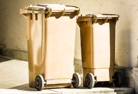 wheeled: two wheeled garbage cans at a sidewalk in austria
