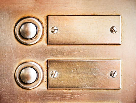 old bell buttons and nameplates - nice background Stock Photo