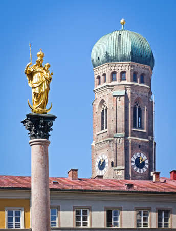 marienstatue and liebfrauendom at the famous marienplatz in munich - germany photo