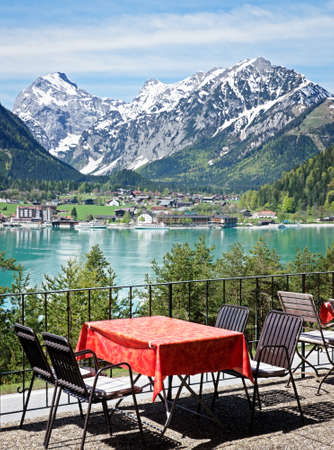 table and chairs at a cafe  achensee