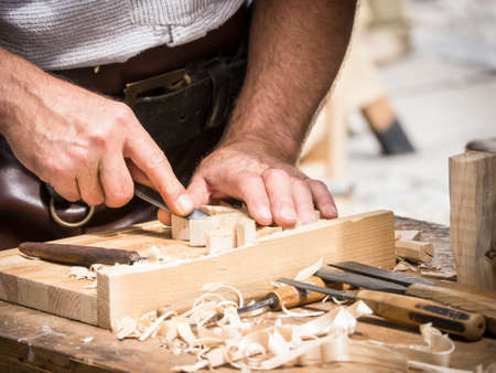wood cutter: carving wood at a festival in mittenwald - germany