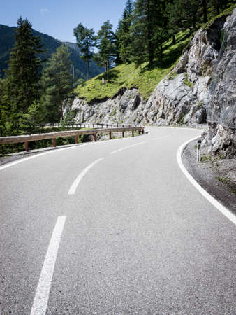 s curve: beautiful winding road in austria - nice background Stock Photo