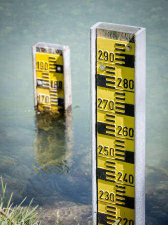 leveling instrument: water level indicators at a river near hamburg