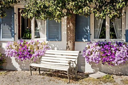 old bench at a bavarian backyard in rosenheim germany Stock Photo - 16907009