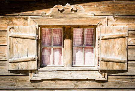 old window at a log cabin near munich Stock Photo - 16907037