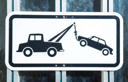 tow truck: no parking sign