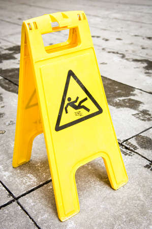 caution wet floor sign at a sidewalk Stock Photo - 17077853