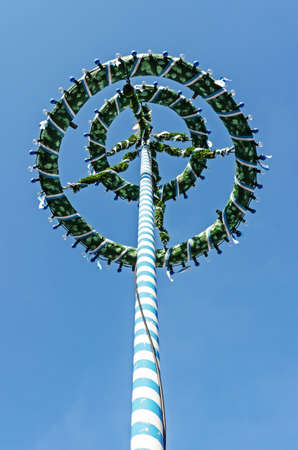 maypole: typical bavarian maypole in front of blue sky