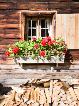 typical bavarian window at an old log cabin Stock Photo - 17078431