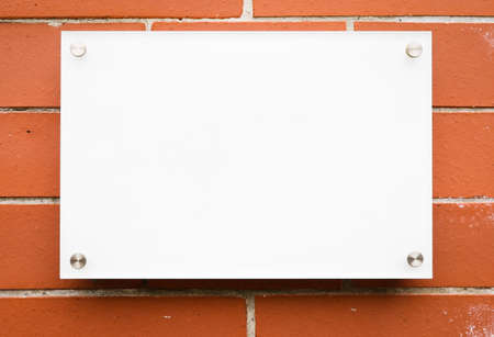 blank sign at a wall - nice background with space for text Stock Photo - 17077740