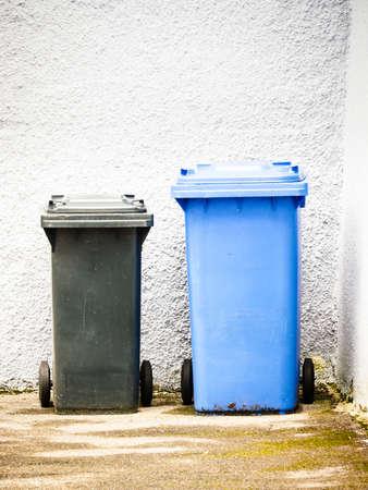 modern garbage bin at a sidewalk