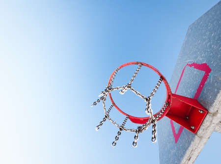 basketball hoop in front of blue sky photo